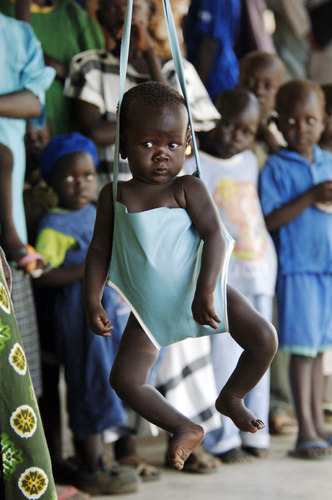 A young child being weighed at a health centre in Juba, Southern Sudan