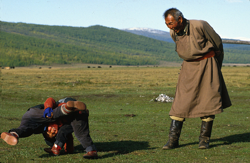 Young Mongolian wrestlers and gran pa referee