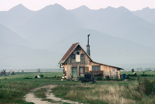 Traditional House in Front of the Fagaras Mountains, Romania