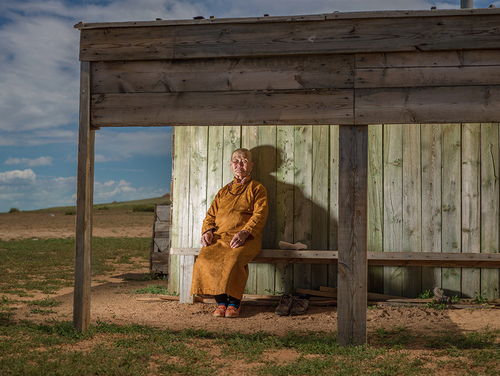 Old Mongolian Lady at Sunset