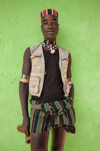 Omo Valley Tribesman Against Green Wall, Ethiopia