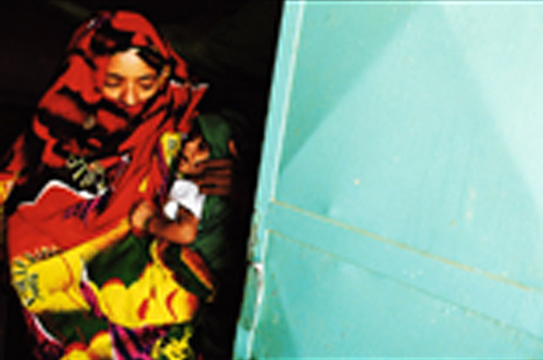 Mother Carrying Her Child Suffering From Malnutrition Out Of Hagaz Healthcare Center Eritrea