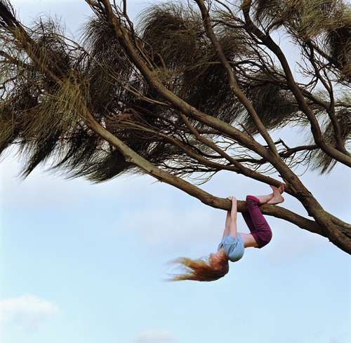 Girl Hanging From Tree